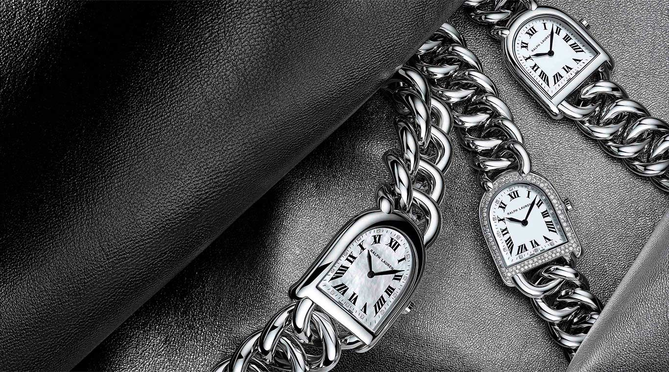 Three stirrup watches with torqued-link bracelets