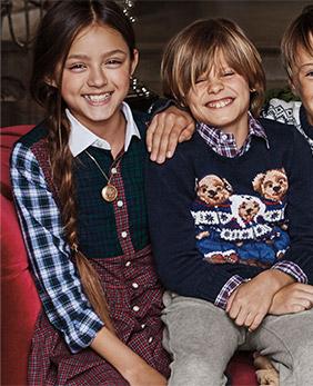 Kids wear festive holiday outfits.