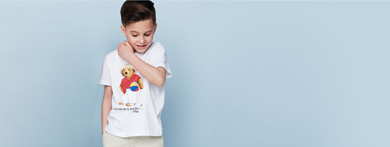 Boy wears Beach Ball Polo Bear T-shirt.