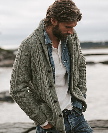Man in sage green cabled cardigan