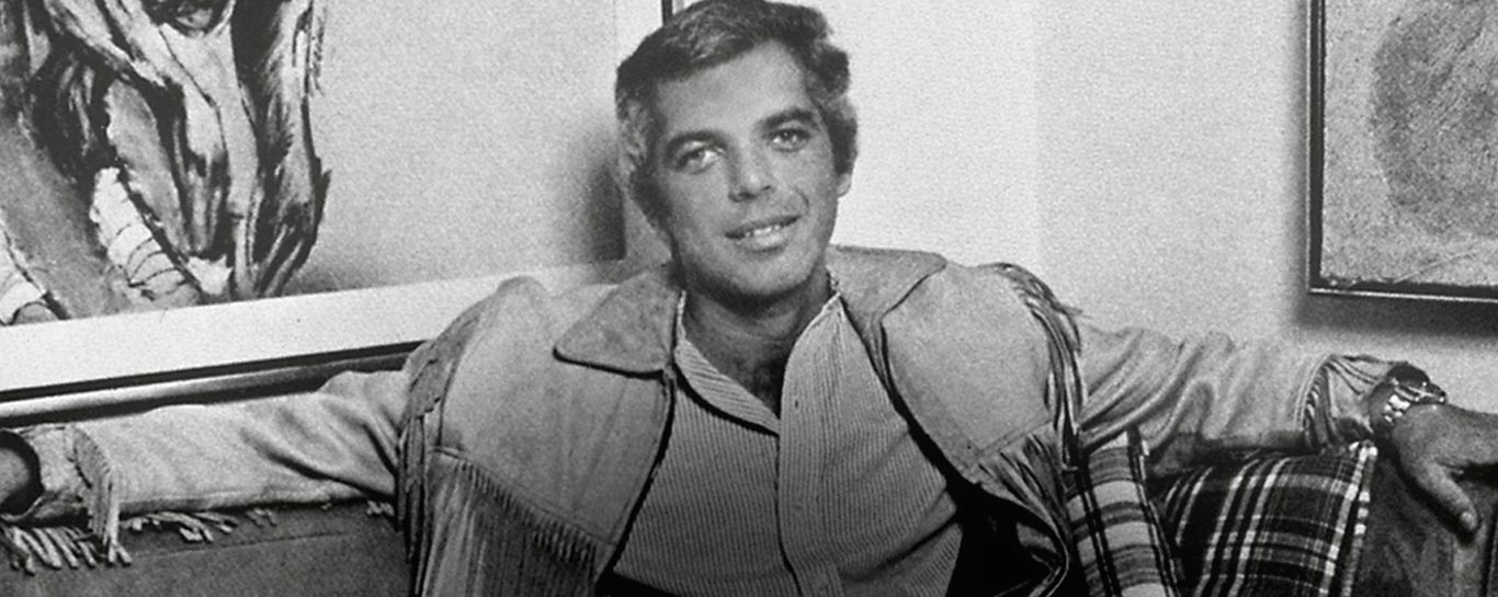 Vintage photograph of Ralph Lauren in fringed suede jacket