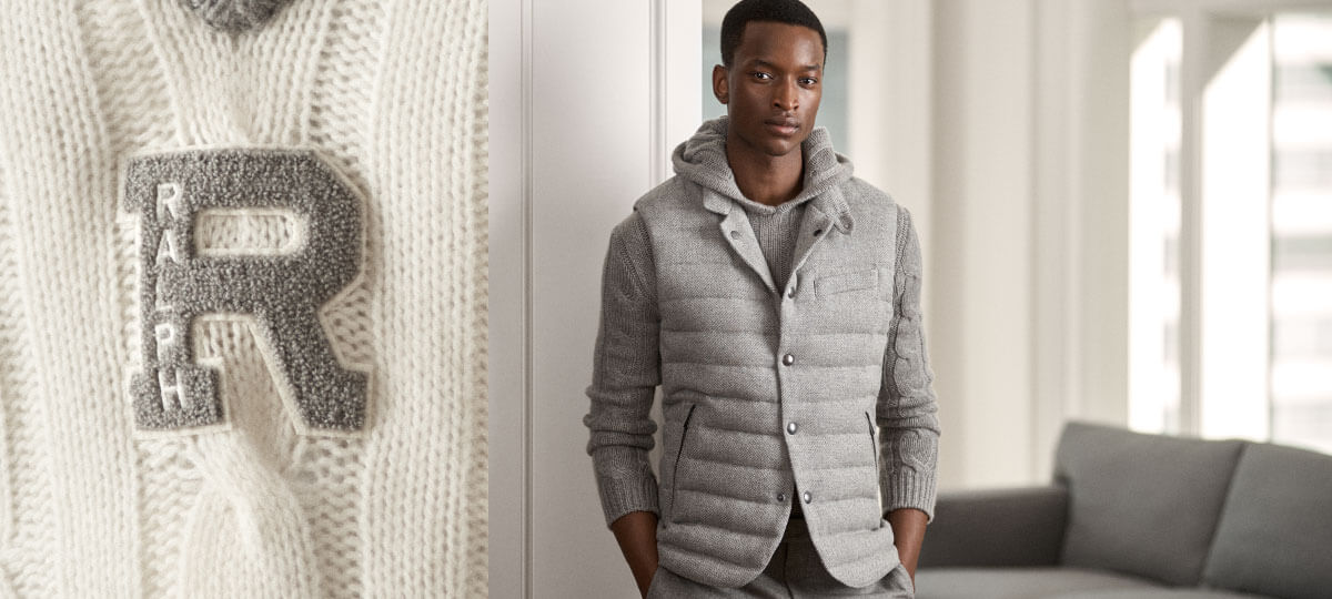 Model in grey wool vest layered over knit hooded sweater