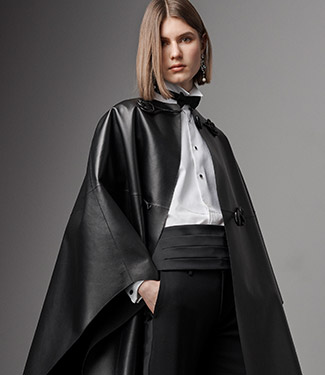 Woman wearing black lambskin cape