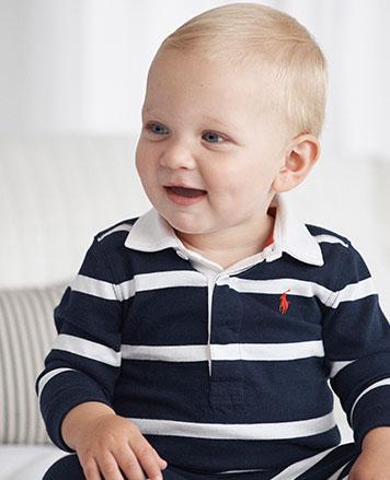 baby boy wears striped Polo shirt.
