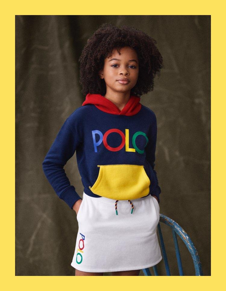 Girls in color-blocked Polo sweatshirt & white drawstring skirt