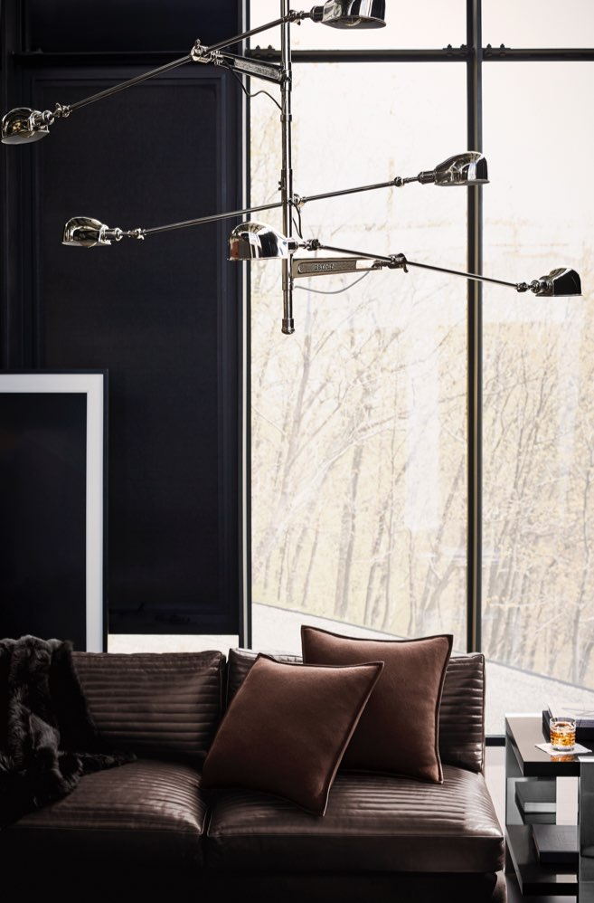 Hanging stainless steel lamp with three arms.