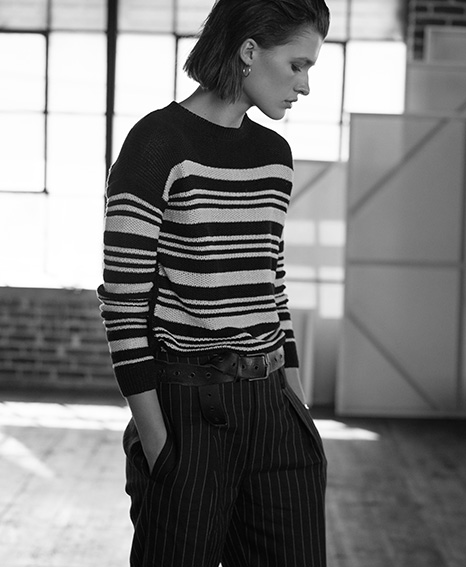 Woman in lightweight striped sweater