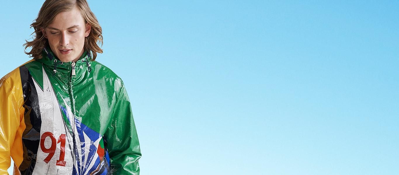 Man in laminated nautical-inspired graphic full-zip hoodie