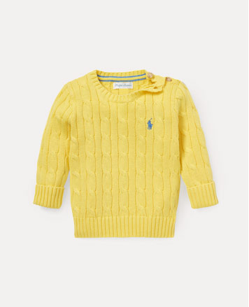 Yellow cable-knit sweater with buttoned placket.