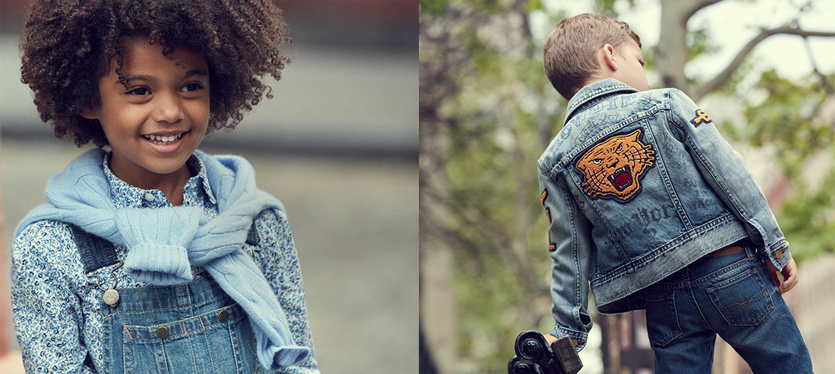 Girl wears denim overalls; boy wears denim jacket with embroidered tiger patch at back.