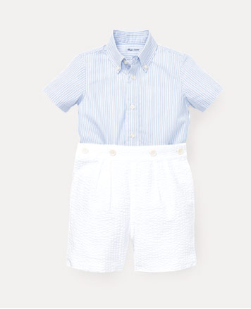 Light-blue button-down shirt and white shorts.