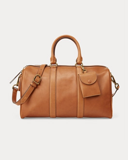 Brown leather duffel bag with luggage tag