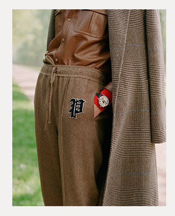 Close-up of drawstring pants with Polo crest patch.