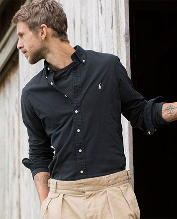 Man in black button-down with white Polo Pony at chest