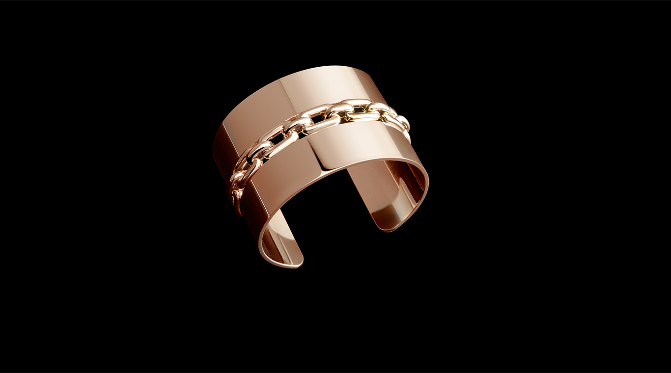 Close-up of rose gold cuff with link accents