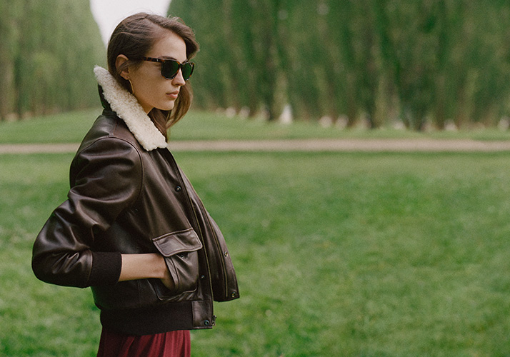 Woman in long, sleeveless grey turtleneck cashmere dress