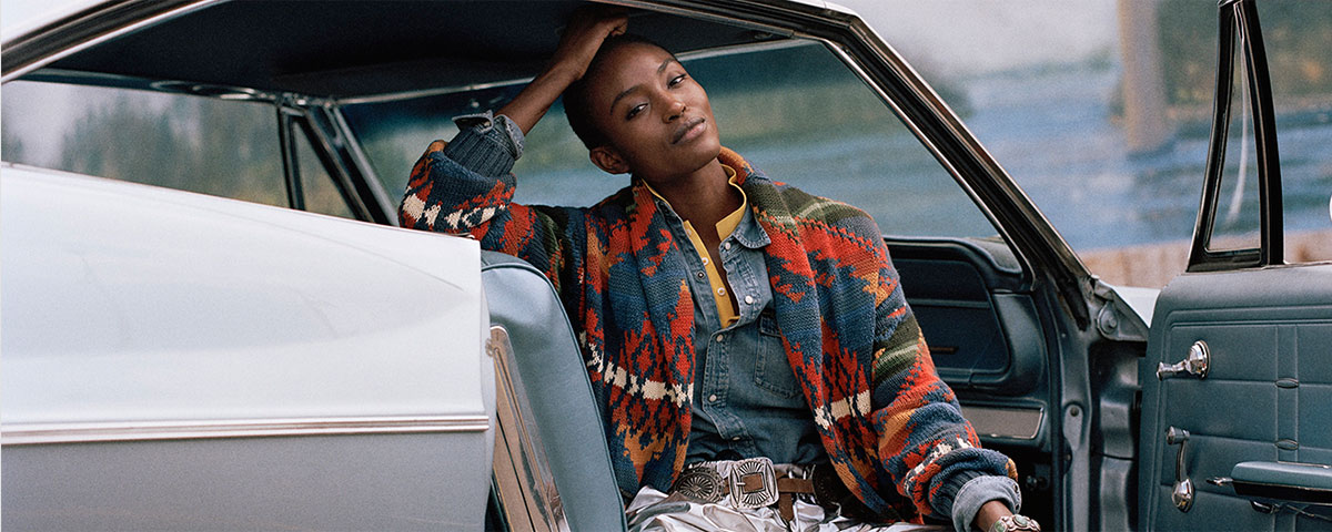 Woman in multicolored Southwestern-motif cardigan & denim shirt