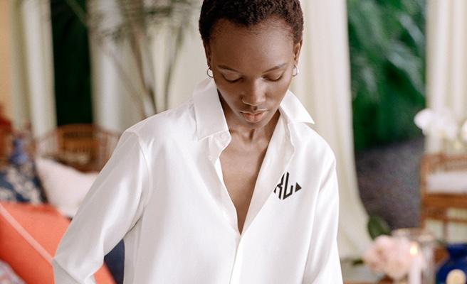 Woman wears personalized white button-down shirt.