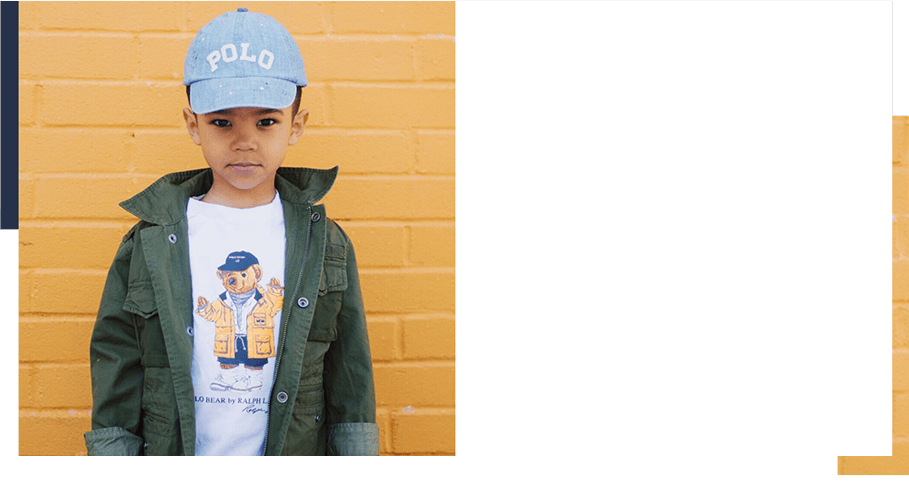 Boy wears Raincoat Polo Bear T-shirt and green jacket.