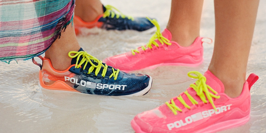 Women on beach wearing multicolored neon lace-up sneakers