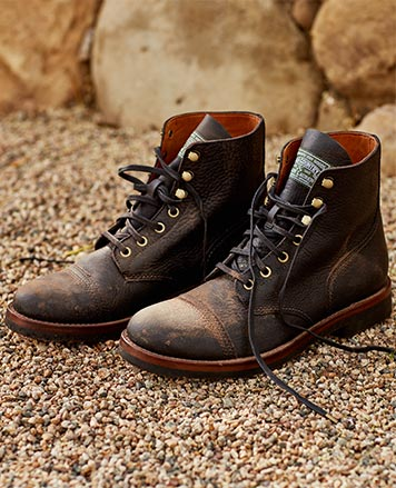 Distressed brown leather boots