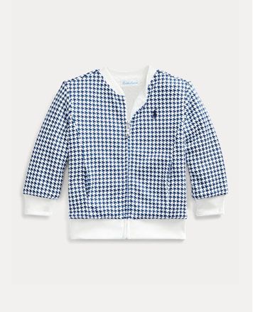 Blue houndstooth zip-front jacket with white cuffs and collar.