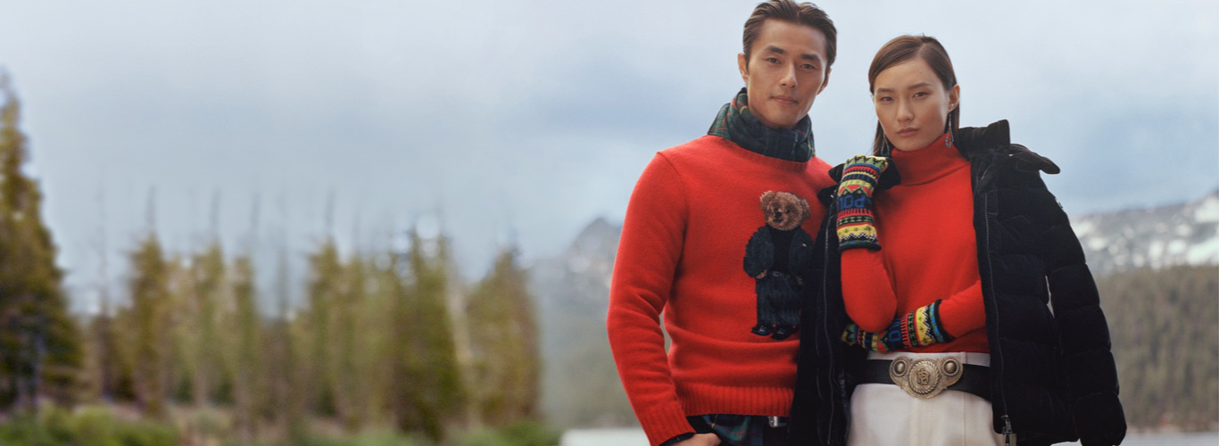 Man in red Polo Bear sweater & woman in red turtleneck