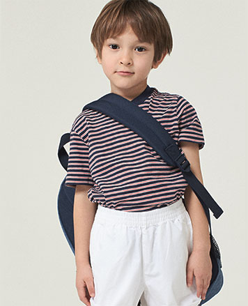 Boy wears striped T-shirt with white shorts.