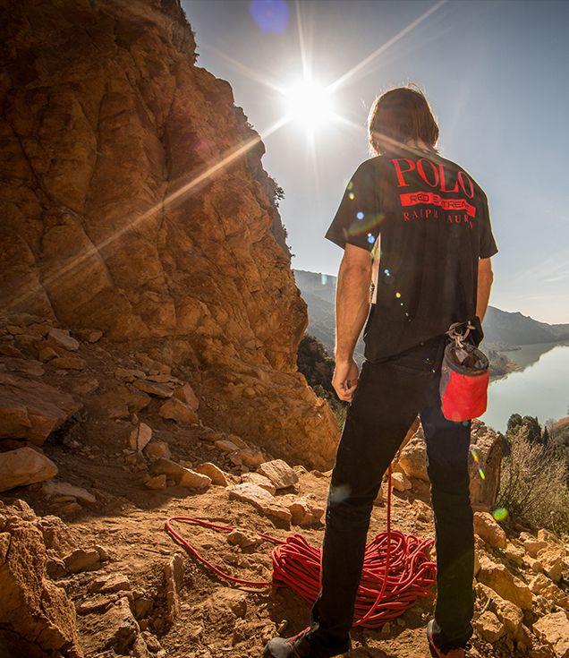 Chris Sharma rock climbing wearing Polo Red Extreme T-shirt