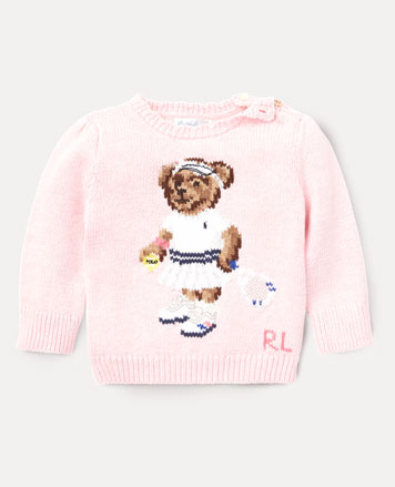 Light-pink sweater with Tennis Bear knit at front.