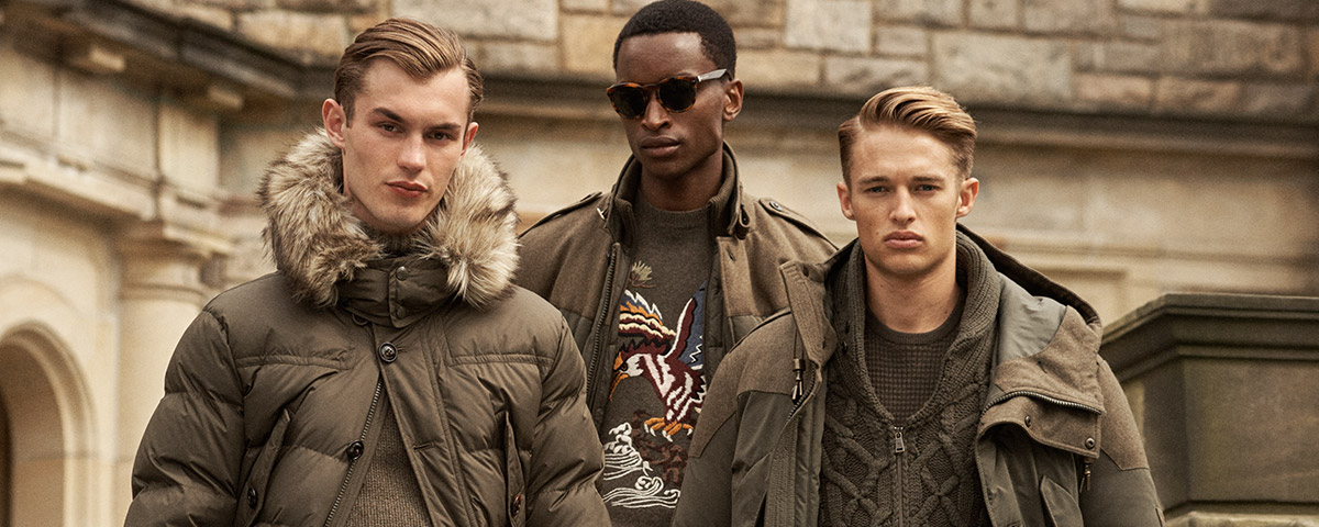 Men in olive-hued knits & outerwear