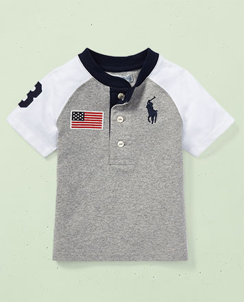 Color-blocked grey-and-white T-shirt with American flag patch.