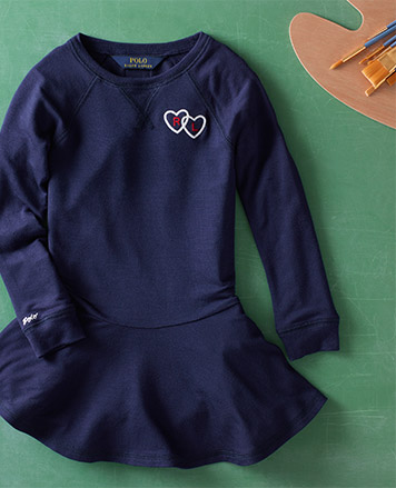 Navy long-sleeve dress with embroidered hearts at the chest.
