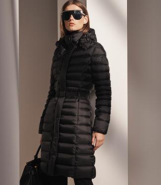 Woman wears cinched-waist black down jacket