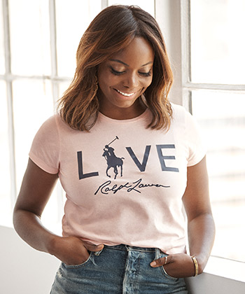 Photograph of Coco Bassey in pink Live Love tee