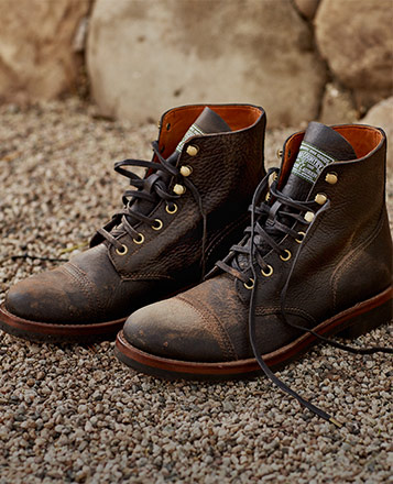 Worn brown leather lace-up boots
