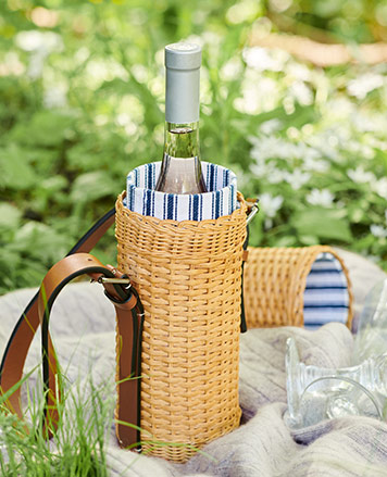 Wicker wine tote with blue-and-white striped lining