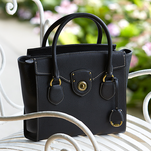 Black leather bag with contrast stitching along borders
