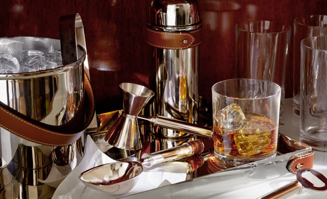 Leather-trimmed silver barware set