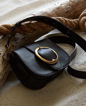 Black leather shoulder bag with large bucket at front