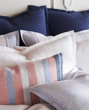 Throw pillows with faded red, white & blue covers