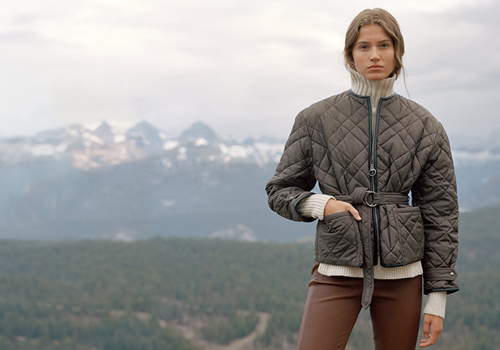 Woman in brown quilted bomber jacket with self-belt