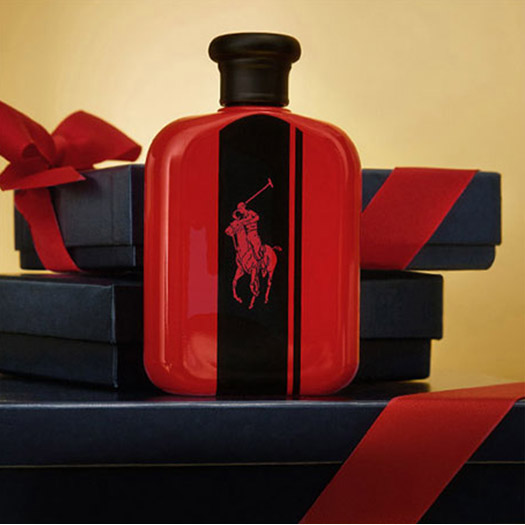 Bottle of Polo Red Intense on stack of navy gift boxes.