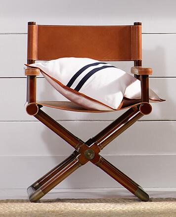 White throw pillow with navy stripes & brown trim