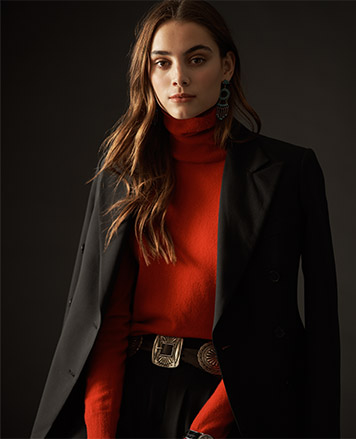Woman in black blazer over red turtleneck