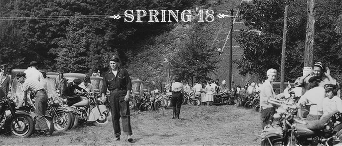 Vintage photograph of bikers on field