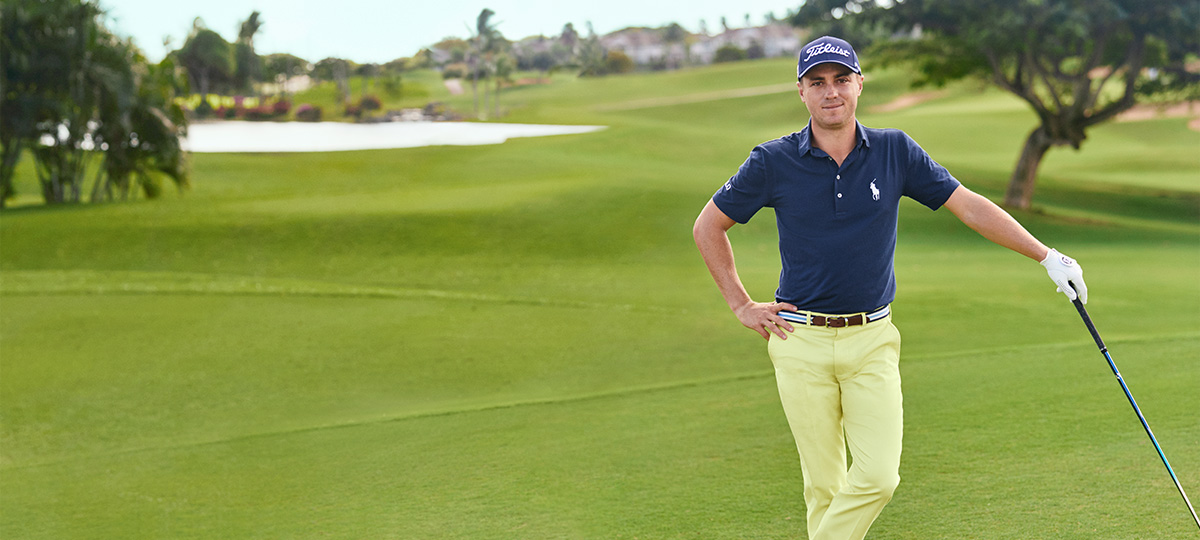 Justin Thomas in navy Golf Polo shirt with white embroidered pony