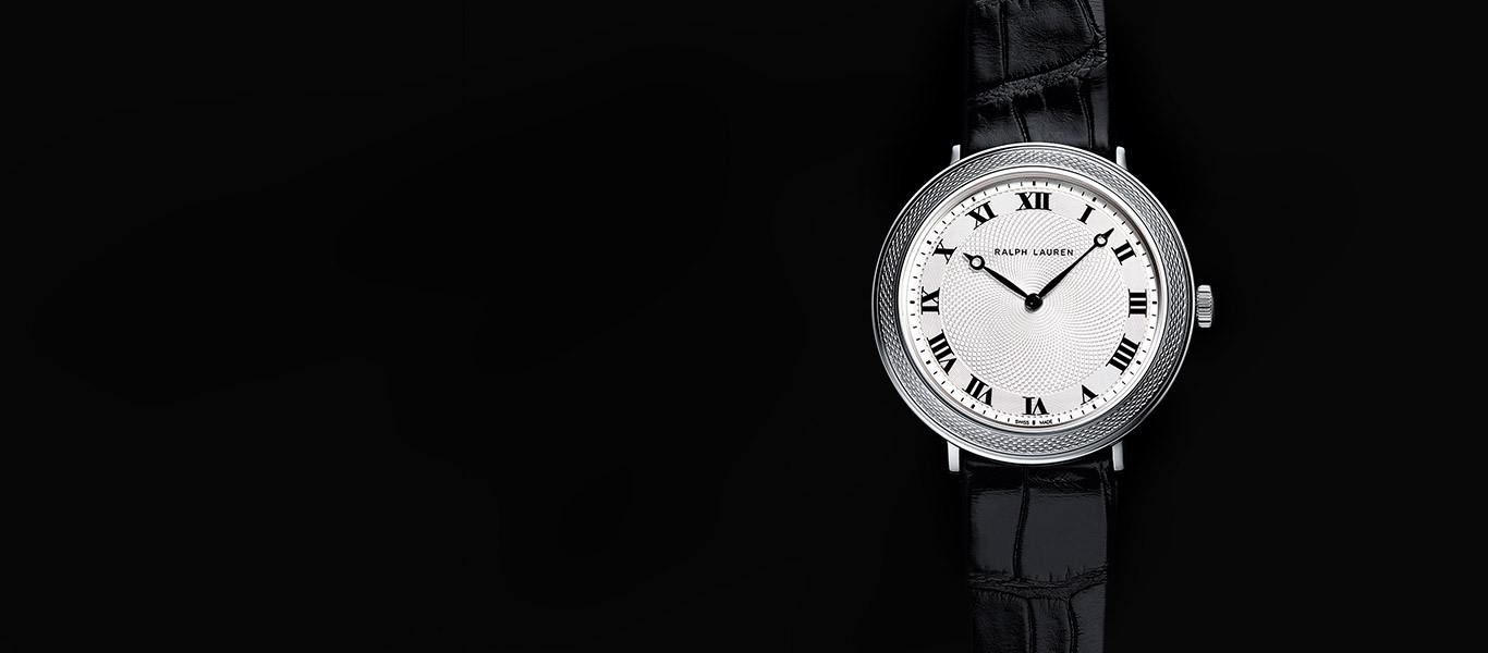 Black-leather-strap watch with round face with Roman numerals
