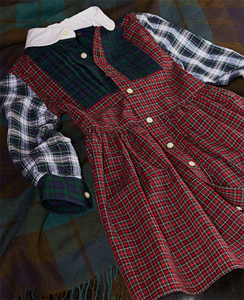 Long-sleeve button-down dress with various tartan patterns.