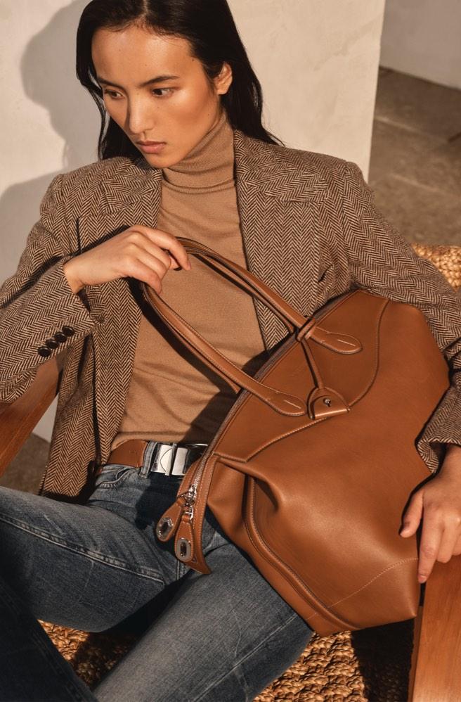 Brown leather bag with zip-top closure, top handles & key bell